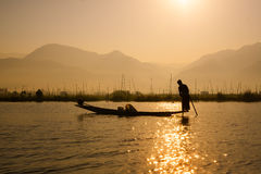 Fishermen catches fish for food in sunrise in Inle lake Royalty Free Stock Photos