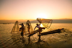 Fishermen catches fish for food in sunrise in Inle lake Stock Photography