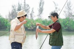 Big fish. Fishermen after catching their big fish outside Stock Images