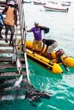 Fishermen catching tuna fish Stock Photography