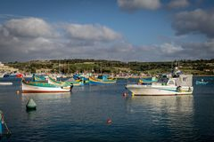 Marsaxlokk bay, lots of luzzu, Malta royalty free stock images