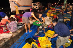 Fishermen are collecting and sorting fisheries after a long day fishing in the Hon Ro seaport, Nha Trang city Stock Photo