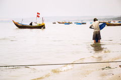 Fishermen with colorful fishing boats on February 7, 2012 in Mui Ne, Vietnam. Stock Image