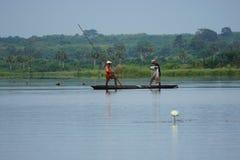 Fishermen in a conoe in the mono delta in Togo stock photography
