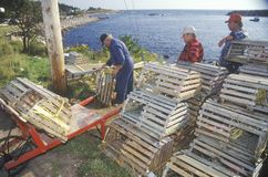 Fishermen with crab traps Stock Images