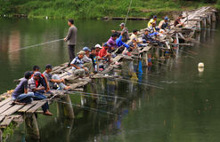 Fishermen Crowd The Bridge Stock Photography