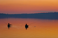 Fishermen in Cyprus lake at sunset Stock Photography