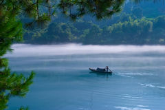 Fishermen at Dawn. Fishermen of the morning mist, east river in china Royalty Free Stock Photos