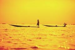 Fishermen at dawn catching fish on Inle Lake stock image