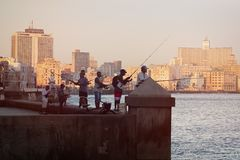 Fishermen at dawn on the famous Malecon seawall in Havana stock photos
