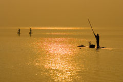 Fishermen at Dawn Stock Photos