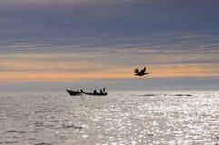 Fishermen at Dawn. Stock Photo