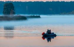 Fishermen at dawn Stock Images