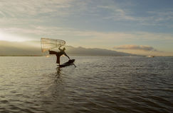 Fishermen at dawn of Inle lake. Myanmar (Burma Stock Photo