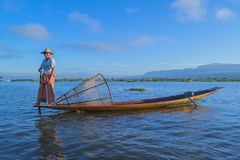 Fishermen at dawn of Inle lake. Myanmar (Burma Stock Images