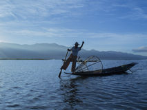 Fishermen at dawn of Inle lake Stock Photography