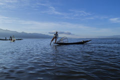 Fishermen at dawn of Inle lake. Myanmar (Burma Royalty Free Stock Image