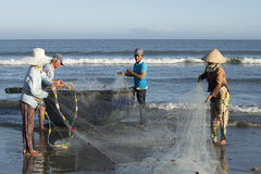 Fishermen dismantle the network before going out to sea. Da Nang, Vietnam Royalty Free Stock Images