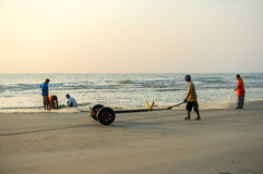 Fishermen do their work near Beserah beach, Kuantan, Malaysia Stock Image