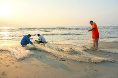 Fishermen do their work near Beserah beach, Kuantan, Malaysia Stock Images
