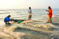 Fishermen do their work near Beserah beach, Kuantan, Malaysia Stock Photography
