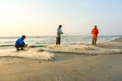Fishermen do their work near Beserah beach, Kuantan, Malaysia Stock Images