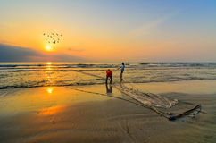 Fishermen do their work near Beserah beach, Kuantan, Malaysia Stock Photos