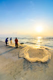 Fishermen do their work near Beserah beach, Kuantan, Malaysia Royalty Free Stock Images