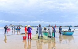 Fishermen are doing work ominous fishing nets Royalty Free Stock Photos