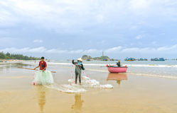 Fishermen are doing work ominous fishing nets royalty free stock photography