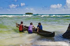 Fishermen with dugout fetch out lobsters and crabs on small island in Carribean Sea Royalty Free Stock Image