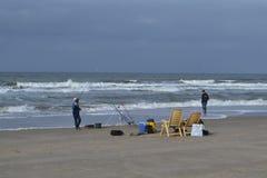 Fishermen at Dutch Northsea coast Stock Photos