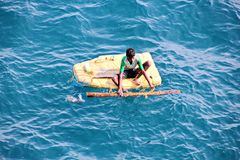 Fishermen are engaged in fishing on improvised floating rafts in the port of Tuticorin, India. Close up view stock image