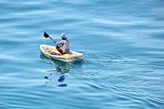 Fishermen are engaged in fishing on improvised floating rafts in the port of Tuticorin, India. Close up view stock images