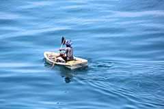 Fishermen are engaged in fishing on improvised floating rafts in the port of Tuticorin, India. Close up view stock photo