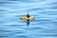 Fishermen are engaged in fishing on improvised floating rafts in the port of Tuticorin, India. Close up view stock photography