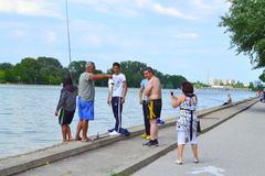Fishermen enjoying  the trophy Royalty Free Stock Images