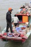 Fishermen family. Live on the boat, amoy city, china royalty free stock photo