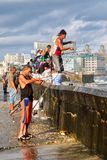 Fishermen at the famous Malecon seawall in Havana. HAVANA,CUBA - NOVEMBER 25,2017 : Fishermen at the famous Malecon seawall, a symbol of the city of Havana Stock Images