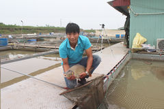 Fishermen and fish farm in river Royalty Free Stock Photography
