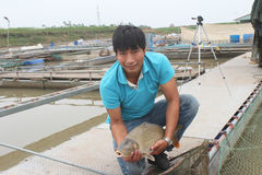 Fishermen and fish farm in river Stock Photos
