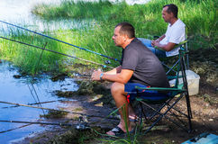 Fishermen fish for fish on the shore Royalty Free Stock Photography