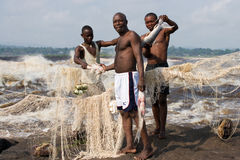 Fishermen with fish near Brazzaville. The rapids of the Congo River. Royalty Free Stock Image
