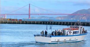 Fishermen on Fishing boat in Fisherman wharf in San Francisco - Stock Image