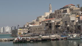 Fishermen and fishing boats at the old port of Jaffa in Tel Aviv Jaffa, Israel stock footage