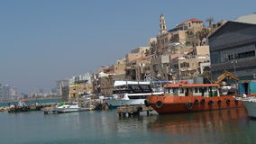 Fishermen and fishing boats at the old port of Jaffa in Tel Aviv Jaffa, Israel stock video