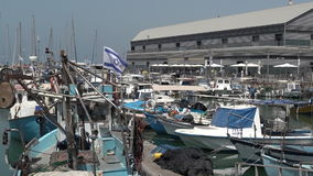 Fishermen and fishing boats at the old port of Jaffa in Tel Aviv Jaffa, Israel stock video footage