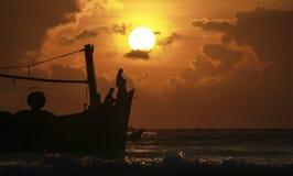 Fishermen fishing at dawn stock photo