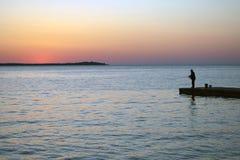 Fishermen fishing on a dock stock image