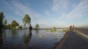 Fishermen are fishing in a field stock footage